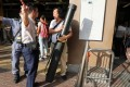 MTR staff move in and prevent a man carrying an oversized item from entering Sheung Shui station yesterday. Photo: Edward Wong