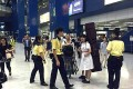 A schoolgirl carrying a guzheng, or Chinese zither, was stopped at Tai Wai Station.
