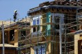 A construction worker at a new home in California as US new single family home sales touched its highest level in 8 years. Photo: Reuters