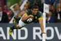 Bryan Habana dives over for South Africa's sixth try. Photos: Reuters