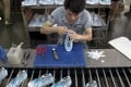 Mainland companies, including factories, were squeezed by rising costs and falling prices in August, with profits falling more quickly during the month than in July. Photo: Reuters