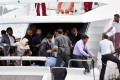 Unidentified injured people are evacuated from Maldives President Yameen Abdul Gayoom's boat in Male on Monday, after an explosion rocked the vessel. Photo: AP