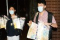 Police show drugs and cash seized from the hotel. Photo: SCMP Pictures