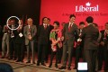 Chinese graft suspect Michael Ching (circled) looks on as Liberal leader Justin Trudeau receives a presentation at a June 15, 2014, gala at the Toronto Sheraton Centre Hotel. A pro-Trudeau group based in Ching's office helped stage the event (others in the photo have no relationship to this group). Photo: Facebook