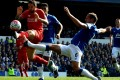 Everton's Phil Jagielka (right) challenges Liverpool's Danny Ings during their English Premier League match at Goodison Park. It ended 1-1. Photo: EPA