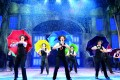 """The staging of """"Singin' in the Rain"""" is a marvel of effortless scene changes."""