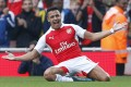 Alexis Sanchez celebrates after scoring his second goal for Arsenal in their 3-0 rout of Manchester United at the Emirates. Photo: Reuters