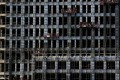 Labourers work on a new residential complex in Beijing in this file photo. The private equity arm of BlackRock is ready to increase its exposure to Chinese commercial real estate. Photo: Reuters