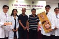 Chinese University medics pose with two patients who took part in the study. Photo: SCMP Pictures