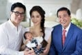 Tycoon Lee Shau-kee (right) with his son, Martin Lee, wife Cathy Tsui and their new child. Photo: SCMP Pictures