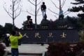 A photo of Chinese tourists posing disrespectfully with statues of firefighters who had lost their lives in an industrial park fire in Zhejiang, sparked anger online. Photo: SCMP Picture