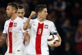 Robert Lewandowski celebrates after scoring the second goal for Poland, who are the top scorers in group A. Photo: Reuters