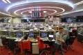 Stock brokers on the trading floor of the Hong Kong stock exchange. Photo: Sam Tsang