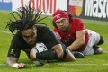Ma'a Nonu crashes over for New Zealand's seventh try. Photos: Reuters