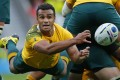 Wallabies scrum-half Will Genia unleashes a pass against Wales in their World Cup clash. Photo: Reuters