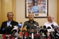 Umno's deputy president Muhyiddin Yassin, former prime minister Mahathir Mohamad and member of parliament Razaleigh Hamzah speak out against Malaysia's Prime Minister Najib Razak.  Photo: Reuters