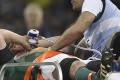 Paul O'Connell takes oxygen as he is stretchered off. Photo: AFP