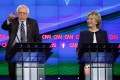 Bernie Sanders makes a point in the first Democratic debate of the campaign as a smiling Hillary Clinton looks on. The former secretary of state was tough, nimble and largely unruffled.Photo: AP
