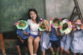 Experienced student volunteer Imogen Yih with children in the city of Dumaguete, in the Philippine province of Negros Oriental.