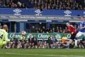 Wayne Rooney scores United's third goal. Photo: Reuters