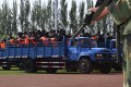 Criminals and terrorism suspects are transported to a stadium for a mass sentencing rally in Yili, Xinjiang Uighur Autonomous Region, in 2014. Photo: Reuters