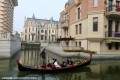 Tourists take a gondola on a canal in Dalian's version of Venice. Photos: Sina.com