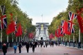 The flags of China and Britain hang on The Mall outside Buckingham Palace. Photo: AFP