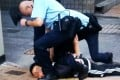 Police officers subdue the suspect. Photo: SCMP Pictures
