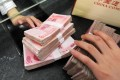 The report signals a new approach to the currency by the People's Bank of China. Photo: AFP