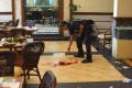 An investigator marks the crime scene where the two people were killed inside the Lighthouse Restaurant. Photo: AP