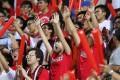 Fans cheer the Hong Kong team against Qatar in a recent World Cup qualifier at the Mong Kok Stadium. Photo: Edward Wong