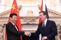 David Cameron, UK prime minister, right, shakes hands with Xi Jinping, China's president, during the UK- China Business Summit held at the Mansion House in London. Photo: Bloomberg