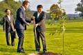 Chinese President Xi Jinping (R) and British Prime Minister David Cameron (2nd R) plant an oak tree symbolizing the China-Britain friendship in Cameron's country retreat, Chequers. Photo: Xinhua