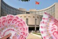 China's central bank has cut interest rates six times in less than a year as growth in the world's second-largest economy slows. Photo: Kyodo