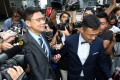 Stephen Chan (left), seen here leaving court on Monday with actor and singer Wong He, was found guilty of one count of agents conspiring to accept advantages. Photo: Felix Wong