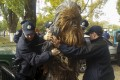 Chewbacca resisted four law enforcement officers, who were forced to pin him down on the hood of a van  to handcuff him. Photo: Reuters