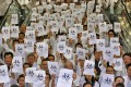 """Doctors display placards reading the Chinese character """"Anger"""" during a sit-in at a hospital in Hong Kong last Wednesday at Queen Elizabeth Hospital. Photo: AP"""