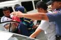 Philippine police escort Chinese suspect Li Quingliang.Photo: AP