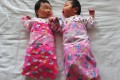 Double happiness: The shackles have been lifted from Chinese couples' reproductive wishes. Photo: AFP