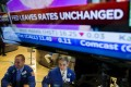 Traders in Wall Street scurry about after the news the US Federal Reserve left interest rates unchanged, as expected, but put a December rate hike in play. Photo: Reuters