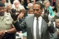 O.J. Simpson during his trial for the murders of his wife and Ron Goldman. Goldman's sister Kim has now written a book  about surviving the media storm.