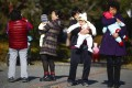 Parents and babies gather at a park in Beijing. Photo: EPA