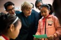 German Chancellor Angela Merkel talks to a student of the Jinputao school in Xinnacun village in the Baohe district of Hefei, China. Photo: AFP