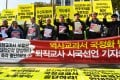 South Korean retired teachers shout slogans during a rally against the revision of the publication system for Korean history textbooks in front the government complex in Seoul. Photo: AFP