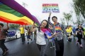 Gay rights activists take part in the Hangzhou marathon. Photo: AP