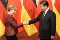 Xi Jinping with Angela Merkel in Beijing last month. Photo: AP