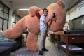 David Begbie from Crossroads Foundation poses with a giant teddy bear in the charity's headquarters in Tuen Mun. Photo: Bruce Yan