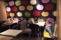 """Dubbed """"McRefugees"""", people sleep at night in 24-hour McDonald's branches around Hong Kong due to homelessness. Photo: AP"""
