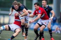 Russia's defence gets to grips with Hong Kong flanker Jamie Cunningham at HKFC on Saturday. The European side beat Hong Kong 31-12 to claim the inaugural Hong Kong Cup of Nations. Photos: HKRU
