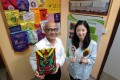 Albert Ho (left), chairperson of Sowers Action, and Brianna Hui, CEO of the charity, hold souvenirs made by children at a Guangxi school supported by the group. Photo: Bruce Yan